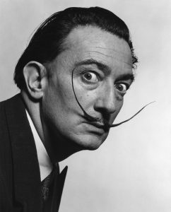 A black and white photograph of Salvador Dali.