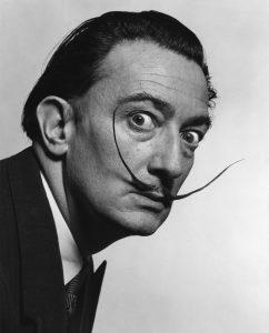 A black and white photograph of Salvador Dali.